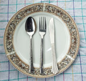 Dish,spoon & fork on table Stock Image