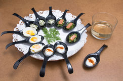 Dish with spoons Stock Images