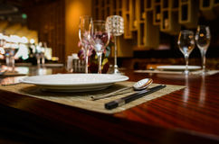 Dish and spoons on dining-table Stock Images