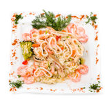 Dish with squid, shrimp, rice and vegetables Royalty Free Stock Images