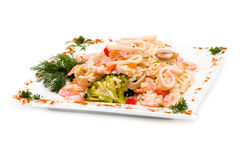 Dish with squid, shrimp, rice and vegetables Stock Photos