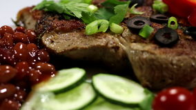 A dish of steak, beans and vegetables. Slide movie stock video