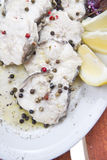 Dish of steamed fish. Second dish of steamed fish with pepper and lemon royalty free stock photos