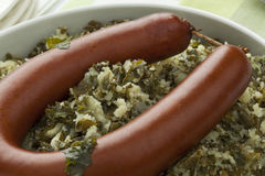Dish with stewed curly kale and sausage Stock Image