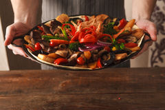 Dish with stewed meat and vegetables on plate Stock Image