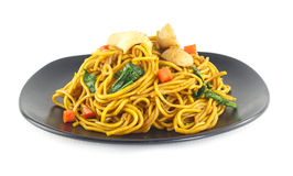 Dish of stir fried yellow noodles with meat and vegetable on whi Royalty Free Stock Photo