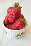 Dish of Strawberries. A small bowl filled with strawberries Stock Images