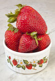 Dish of Strawberries. A small bowl filled with strawberries stock photo