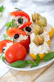 Dish with stuffed tomato and peach. Choice of snack with stuffed tomato and peach Stock Image