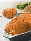 Dish of Sweet Potato Mash with a spoon Royalty Free Stock Photography