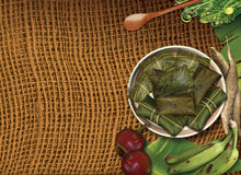 Dish with tamales wrapped in banana leaves stock images
