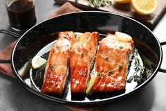 Dish with tasty cooked salmon on table. Closeup Royalty Free Stock Photography