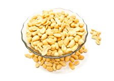 Dish with tasty peanuts. Dish with peanuts on white background closeup Royalty Free Stock Image