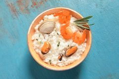 Dish with tasty seafood risotto. On table Stock Photos