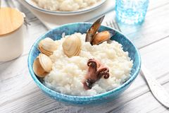 Dish with tasty seafood risotto. On table Stock Images