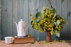 Dish for tea cups and flowers of linden in vase Stock Image