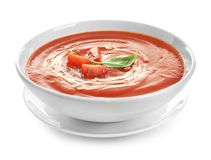 Dish with tomato cream soup on white background. Healthy food stock photos