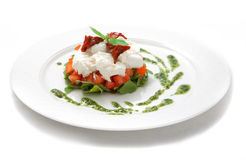 Dish with tomatoes, salad ruccola and cheese Stock Image