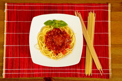 Dish with tometo spaghetti Stock Images