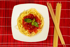 Dish with tometo spaghetti. And basil Royalty Free Stock Photography