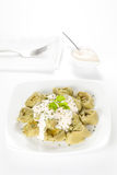 Dish of tortellini with cheese sauce Royalty Free Stock Images