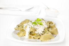 Dish of tortellini with cheese sauce Stock Photo