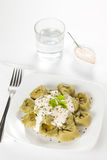 Dish of tortellini with cheese sauce Royalty Free Stock Photos