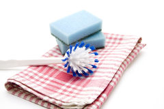 Dish towel and Rinsing brush Royalty Free Stock Photos