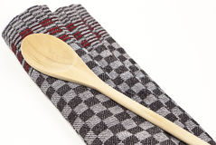 Dish Towel and wooden Spoon Royalty Free Stock Image