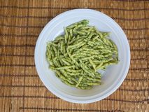 Dish of trofie al pesto: handmade pasta with basil sauce royalty free stock photos