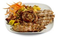 Dish with various meats and potatoes Stock Photos