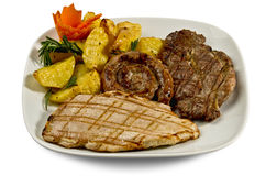 Dish with various meats and potatoes Royalty Free Stock Image