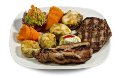 Dish with various meats and stuffed mushrooms Royalty Free Stock Photography