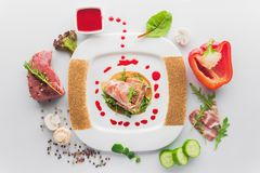 Dish of veal with red pepper, meat rolls, fresh mushrooms. And vegetables ingredients. restaurant food on white background Royalty Free Stock Images