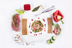 Dish of veal with red pepper, meat rolls, fresh mushrooms Royalty Free Stock Photo