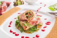 Dish of veal with red pepper, meat rolls, fresh mushrooms. And vegetables ingredients. restaurant food on white background Stock Photo