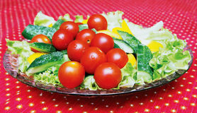 Dish with vegetables. Dish with the expansion of its tomatoes, cucumbers, peppers and lettuce listmi Stock Photography