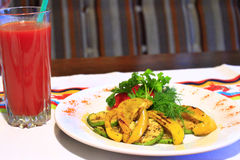 Dish for vegetarians vegetables grilled and tomato juice Royalty Free Stock Photography