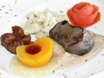 Dish of venison with fruits Royalty Free Stock Photos