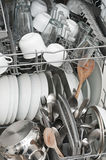 Dish washer with clean and shiny dishes Stock Photo