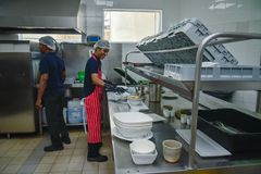 Dish washers working at the kitchen stock images