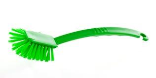 Dish-washing brush. Green dish-washing brush isolated on white background Stock Image