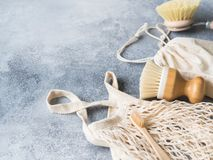 Dish washing brushes, bamboo toothbrushes, reusable bag. Sustainable lifestyle zero waste concept. Clean without waste. No plastic royalty free stock photos
