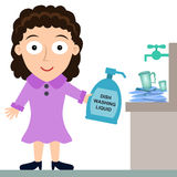 Dish washing liquid. A young woman holding a dish washing liquid Stock Photography