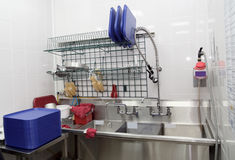 Dish washing room in a restaurant Stock Photos