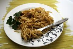 Dish with spaghetti on pasta Stock Photo