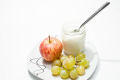 Dish with yogurt, apple and grapes Stock Photo