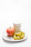 Dish with yogurt, apple and grapes Stock Photography