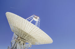 Dishes antenna. Giant Satellite dishes antenna over blue sky royalty free stock photos
