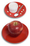 Dishes with apple and pills Royalty Free Stock Images